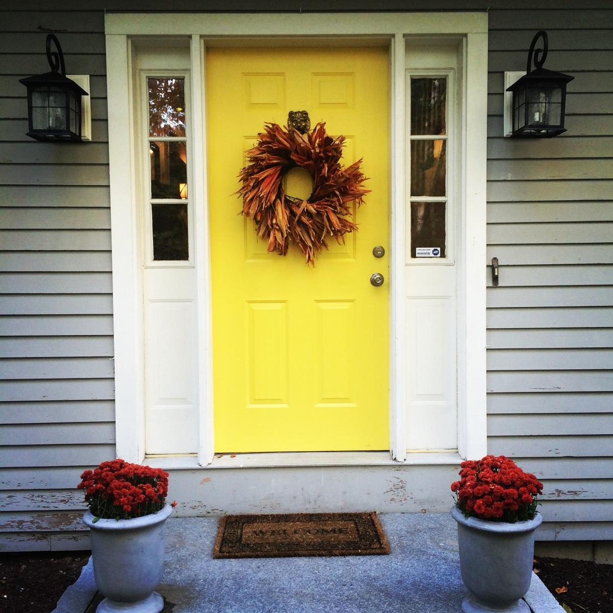 Yellow Front Door On Hitching Post Lane